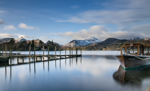 Causey Pike in snow beyong the Keswick launches jetty