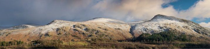 panoramic view of the Helvellyn range with a smattering of snow