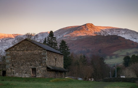 High Pike over Ambleside and the barn at Galava Fort